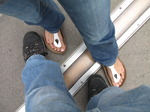 SX15933 Marijn and Marieke's feet across prime meridian at Old Greenwich Royal Observatory, London.jpg
